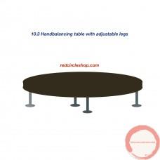Handbalancing table with adjustable legs.